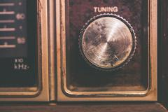 vintage tuning dial in aged radio device. closeup photo. - stock photo