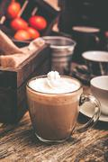 hot cocoa drink with whipped cream in clear glassy mug. - stock photo