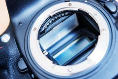 dslr camera mirror. professional camera mirror and lens mount closeup. camera - stock photo