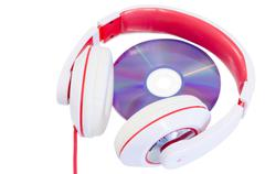 audio compact disc and red white headphones - stock photo