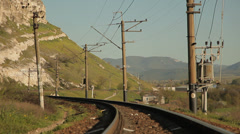 High speed train. Mountain landscape. Shoot from railroad tracks. Stock Footage
