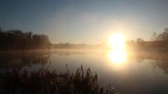 Pan across sunrise on lake Stock Footage