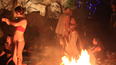 Men and women dancing around a campfire under the game reels, Phangan, Thailland Stock Footage