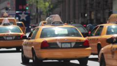 Cars yellow cabs street traffic in New York City Stock Footage