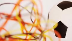 Fussball und Schläuche mit schwarzer, roter, gelber Farbe Stock Footage