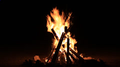 Bonfire lit at night Stock Footage