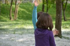 Two Little Girls Playing In A Dandelion Fluff Field, Nature, Outdoor, Fun - stock photo