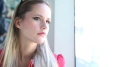 Beautiful young woman looking out the window while riding tram - stock footage