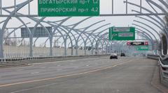 Cars riding on Western High-Speed Diameter tollway in Saint-Petersburg, Russia Stock Footage