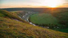 Picturesque sunset in a valley with a river Stock Footage