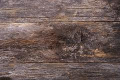 Aged wood backdrop. old reclaimed wood plank closeup. Stock Photos
