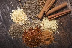 aromatic dry spices. cinnamon sticks, crushed red pepper, thyme, garlic and m - stock photo
