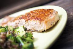 Tasty grilled wild caught salmon, wild rice and broccoli dinner closeup. Stock Photos