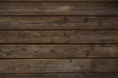 Reclaimed dark wood background. horizontal old weathered planks. Stock Photos