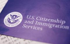 Us homeland security citizen and immigration services flyer closeup. Stock Photos