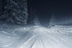 Colorado winter storm at night. country road covered by heavy snow. Stock Photos