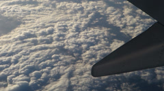 A sea of clouds seen from an airplane window - stock footage
