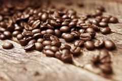 Coffee beans on vintage wood table closeup. Stock Photos