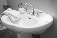 wash basin with decor in bathroom - stock photo