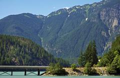 north cascades mountains landscape with bridge on the lake. washington state, - stock photo