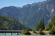Stock Photo of north cascades mountains landscape with bridge on the lake. washington state,