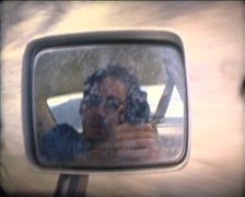 SUPER8 cameraman in car mirror reflection Stock Footage