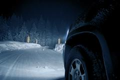 Dangerous winter road at night. colorado road drive in snow storm. Stock Photos