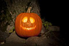 spooky jack-o-lantern outdoors - stock photo