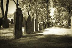old cemeteries - row of tombstones - stock photo