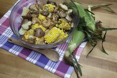 Colorful Shrimp, Corn, and Potatoes in a Bowl for a Shrimp Boil Feast - stock photo