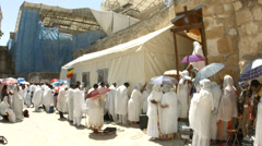 4K UHD Ethiopian Orthodox pilgrims at Deir es Sultan by the dome of St. Helena Stock Footage