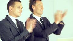 Business SE 032 Businessmen applaud speaker at business forum Stock Footage
