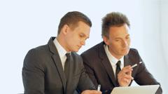 Stock Video Footage of business SE 035 businessman convincingly explains his companion