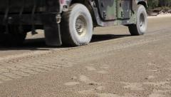 camouflage military humvee drives down beach with soldiers     (courtesy DOD) - stock footage