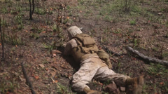 us army soldier fires weapon from laying position in training exercise - stock footage