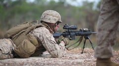 Army soldier work with ammunition magazine on firing range at training exercise - stock footage