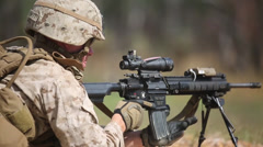US Army soldier aims his weapon at firing range in joint training  exercise - stock footage