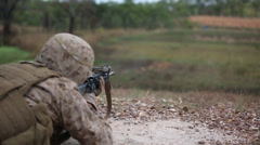 US Army soldier aims his weapon at joint training exercise     (courtesy DOD) - stock footage