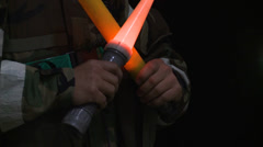 Air Force ground crewman holds flashlights to communicate with pilots Stock Footage