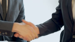 Business SE 045 close-up of shaking hands seated companions Stock Footage