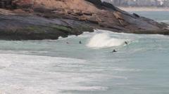 1306028 - Arpoador beach, Rio de Janeiro, young man getting surf Stock Footage