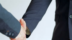 business SE 050 close-up of a handshake standing companions - stock footage