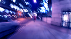 City rush hour , people rushing through city at night Stock Footage