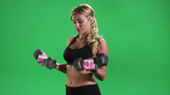A Blonde Girl Works out with Weights Stock Footage