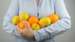 woman lemons and oranges - stock footage