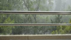 Rain on a railing on stainless steel Stock Footage