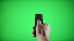 Remote control television changing three channels Stock Footage