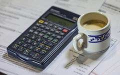 utility bills, coffee and calculator - stock photo