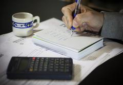 Calculation of the utility bills Stock Photos