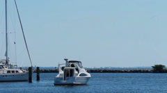 Yacht heading out to sea on beautiful clear day Stock Footage
